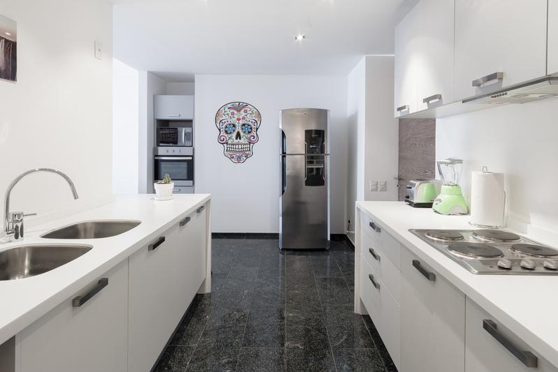 Kitchen at Magenta Apartment Reforma