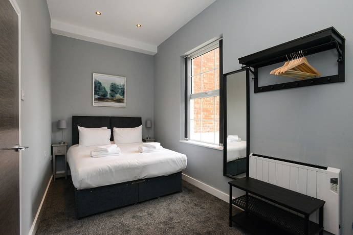 Double bed at Arena Serviced Apartments