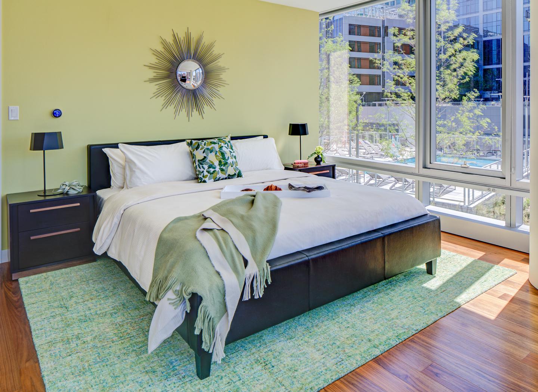 Comfortable bed at The Benjamin Serviced Apartments