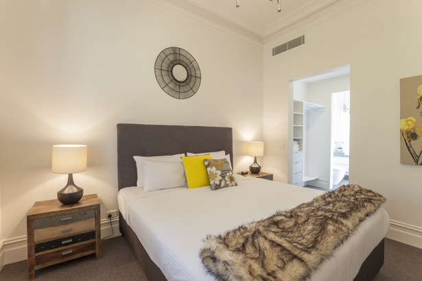 Stylish bedroom at Contempo Apartment