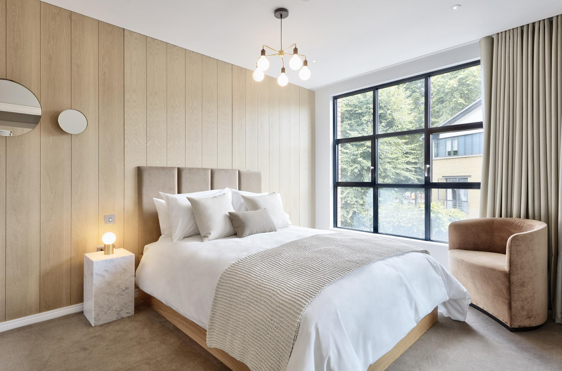 Queen size bed at STAY Camden Serviced Apartments