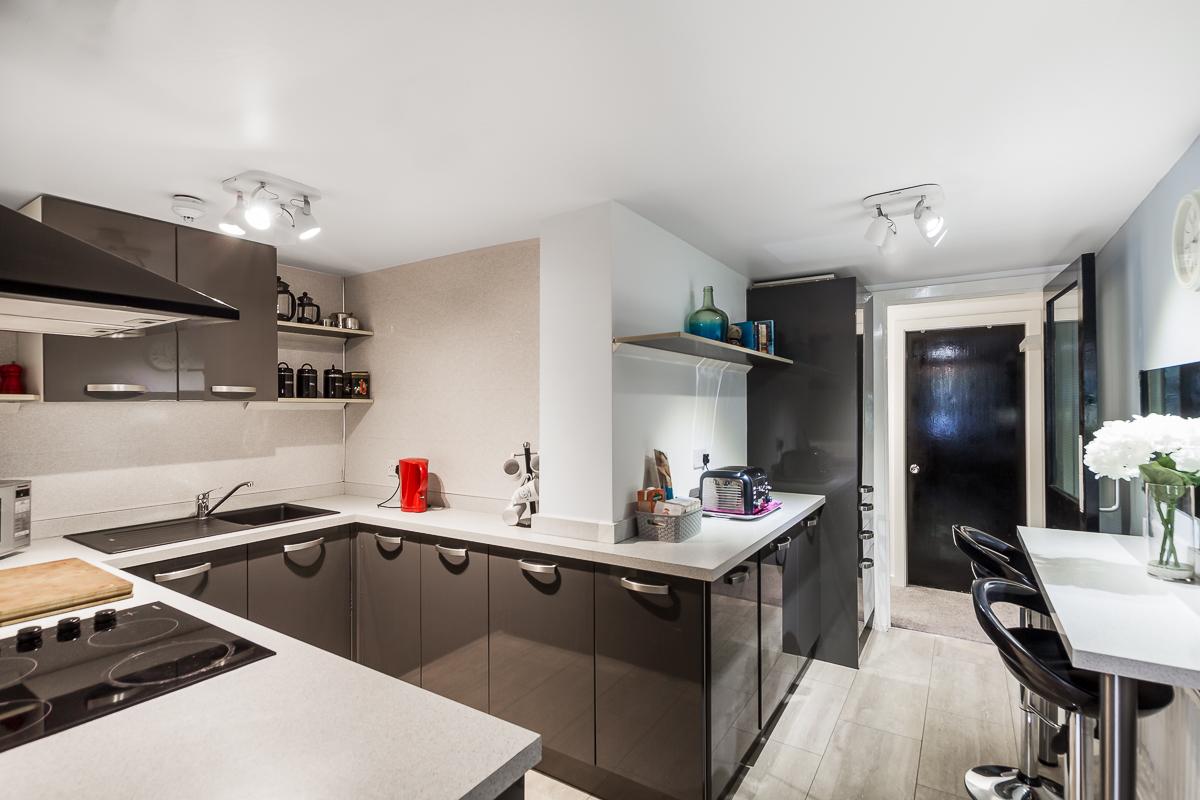 Spacious kitchen at Suitestayzzz Apartments