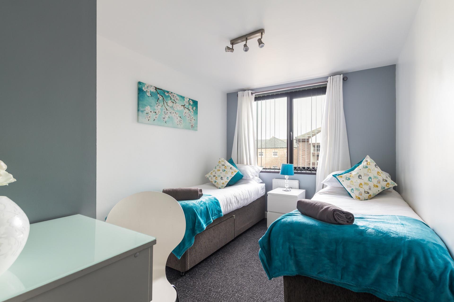 Bright bedroom at Suitestayzzz Apartments