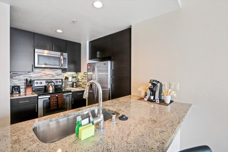 Fully equipped kitchen at 388 Beale Corporate Housing