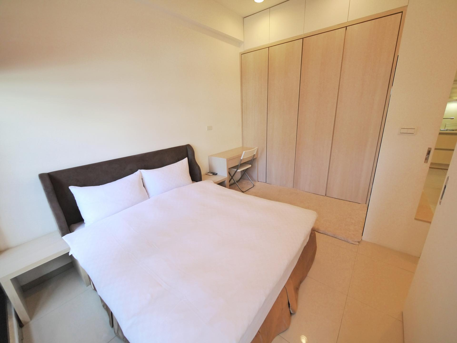 Double bed at CK Serviced Apartments
