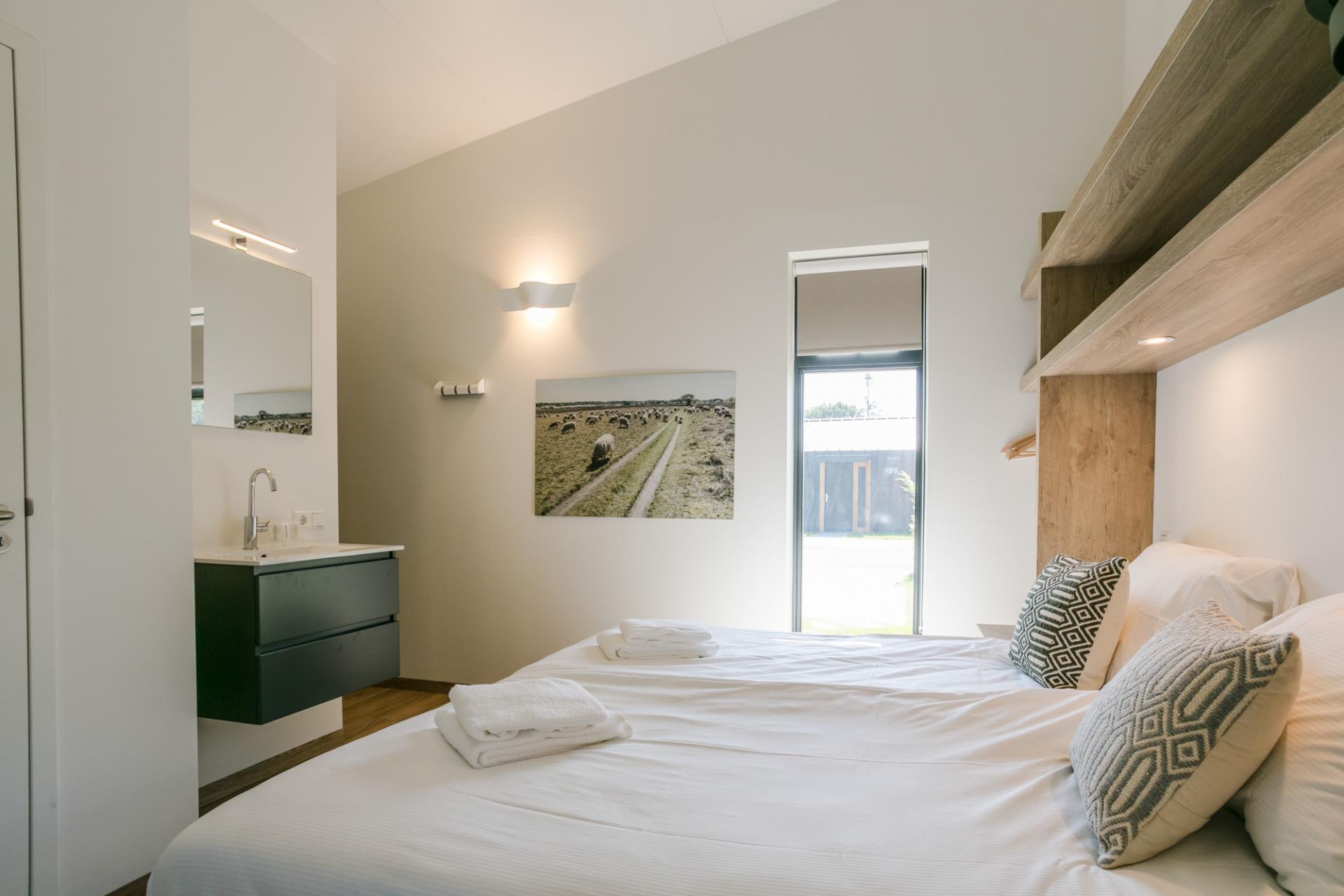 Bright bedroom at Gooilanden Lodges