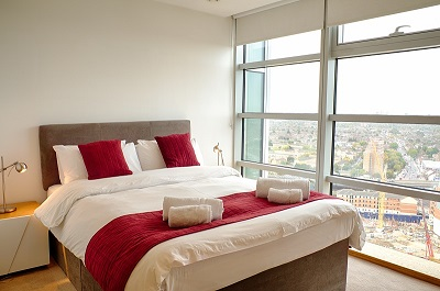 Double bed at Pioneer Point Apartments