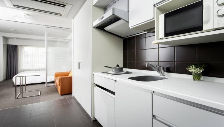 Kitchen at Citadines Shinjuku Apartments
