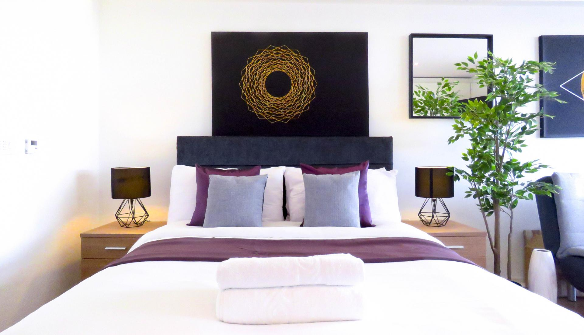 Bed at The Cube Serviced Apartments