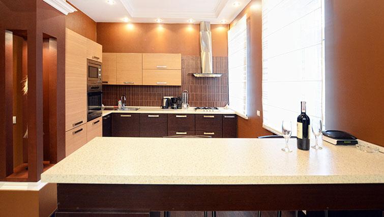 Brown kitchen in Mala Zhitomirskaya Apartment