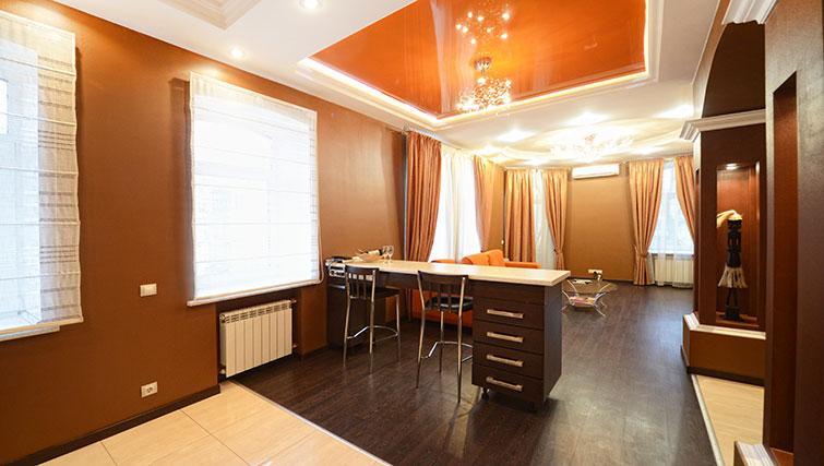 Living/dining area at Mala Zhitomirskaya Apartment