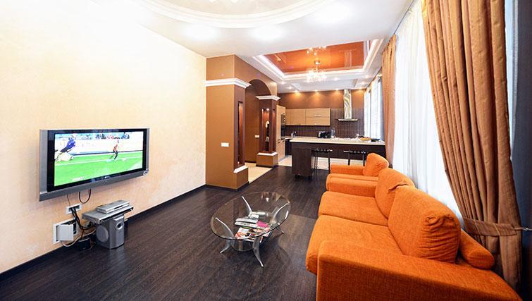 Open-plan living area at Mala Zhitomirskaya Apartment
