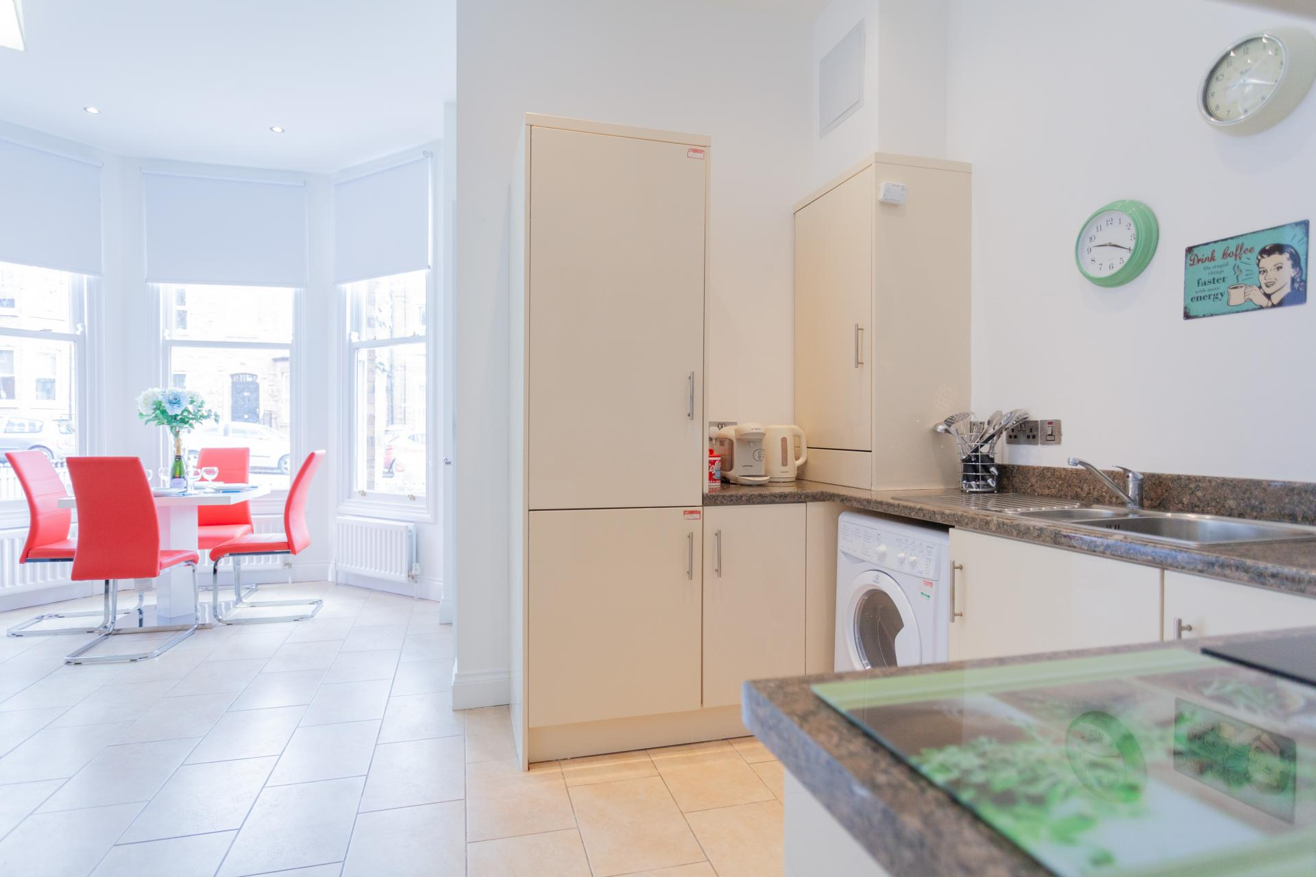 Open-plan kitchen at Haven Serviced Apartments