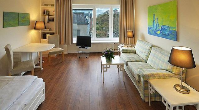 Spacious living area in Oberhouse Apartments