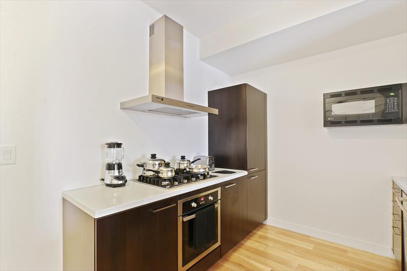 Kitchen facilities at Apex Serviced Apartment