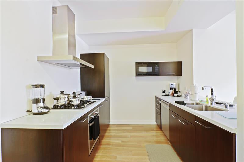 Kitchen at Apex Serviced Apartment