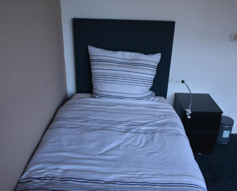 Comfortable bed at Business Korenstraat Apartment
