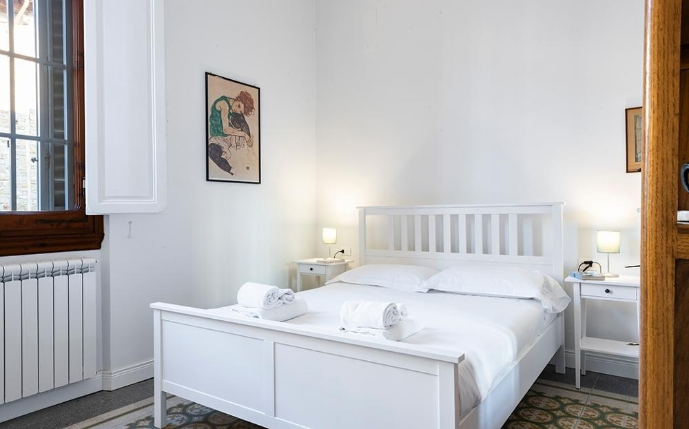 Double bed at Fiordaliso Apartment
