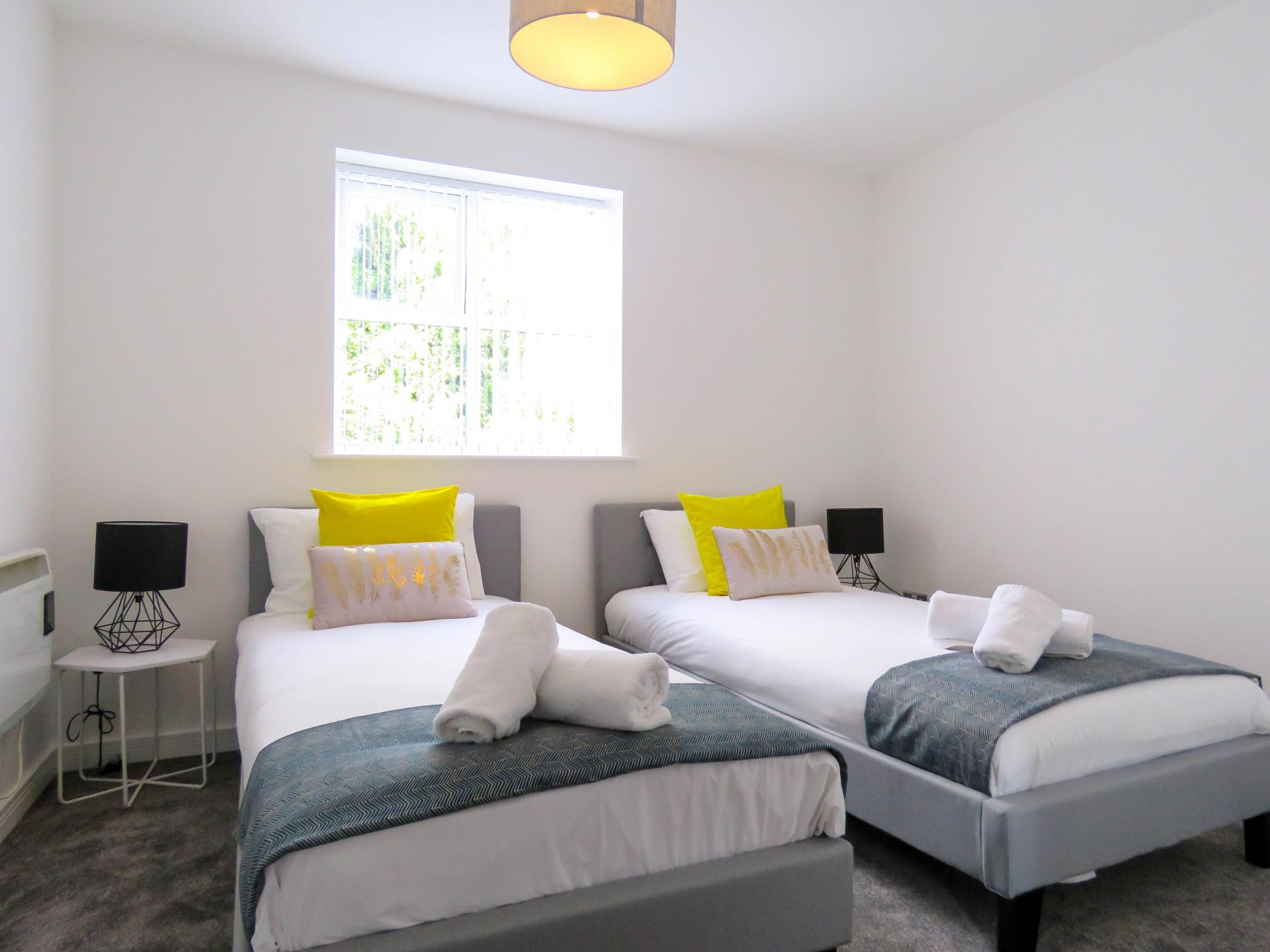 Twin beds at ICC and Canal Side Serviced Apartment
