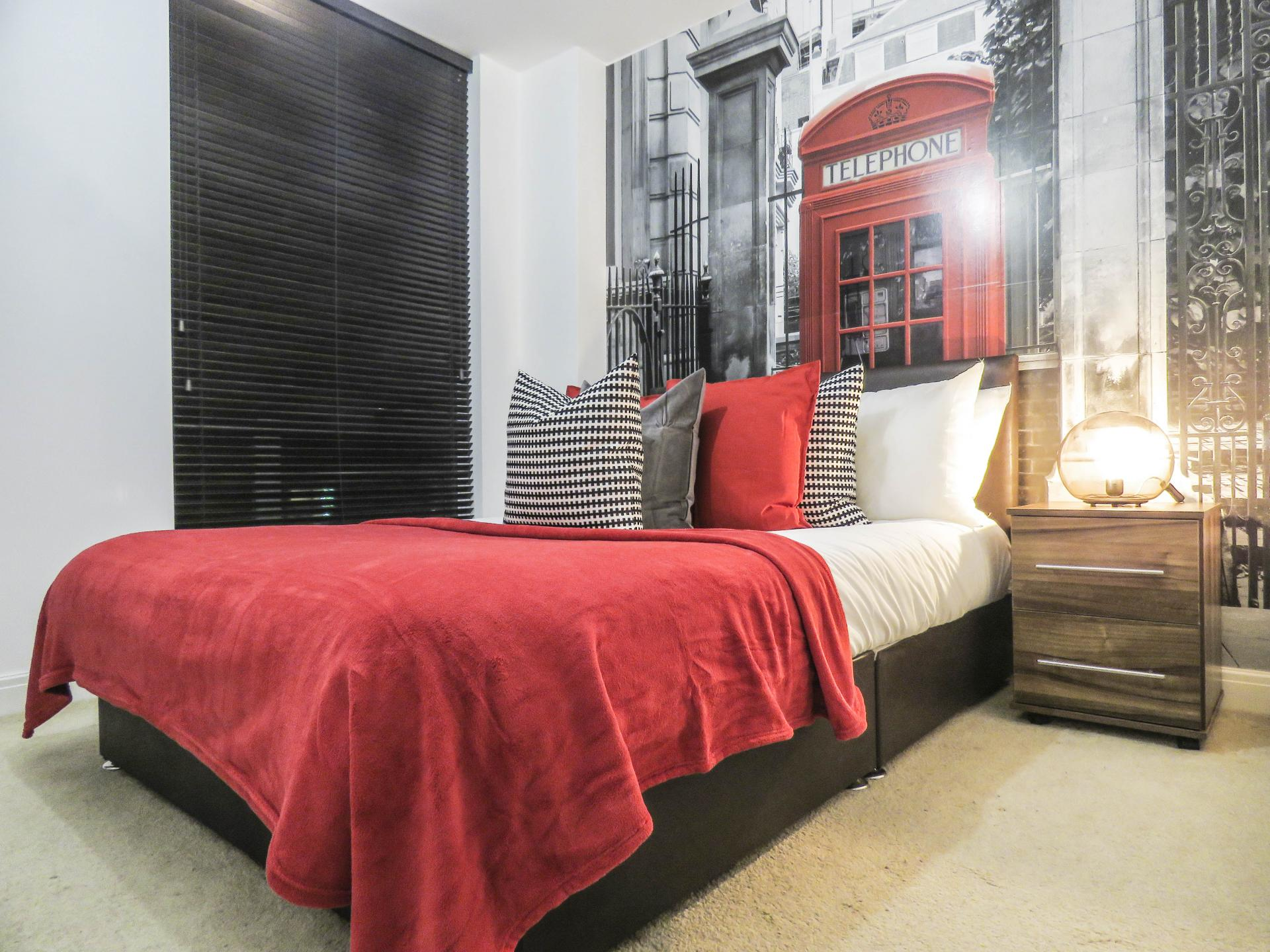 Double bed at Lion Court Serviced Apartment