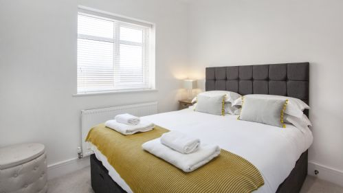 Cosy bed at White House Apartments