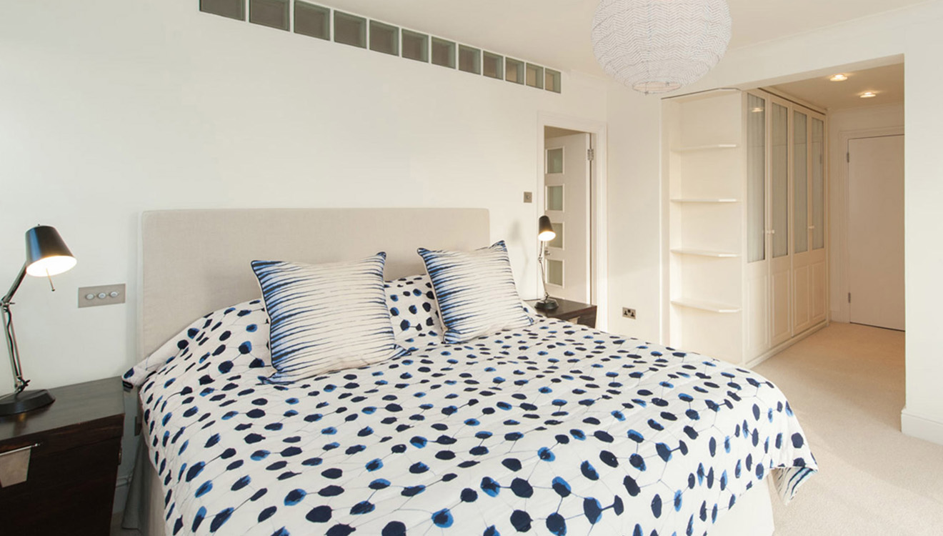 Modern bedroom at Europa House Apartments