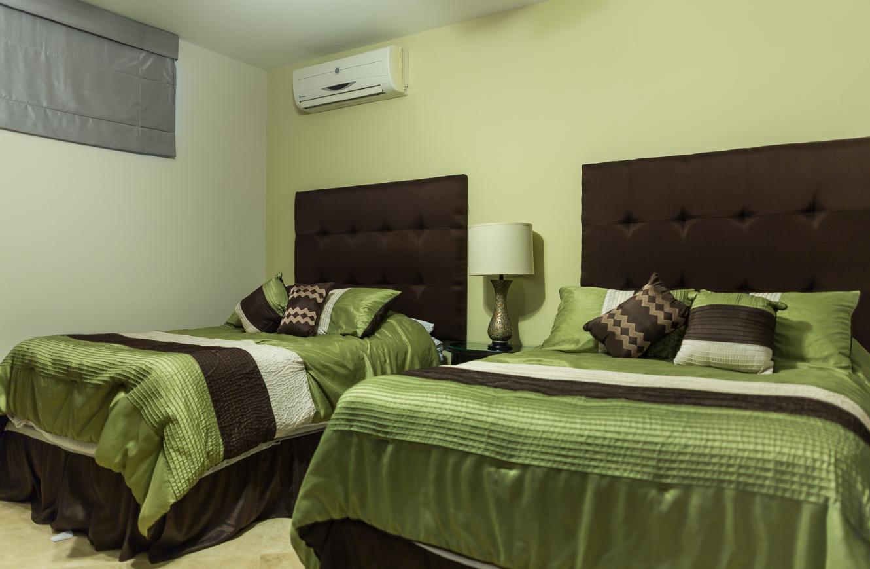 Twin beds at Cascadas De Pedregal Apartment