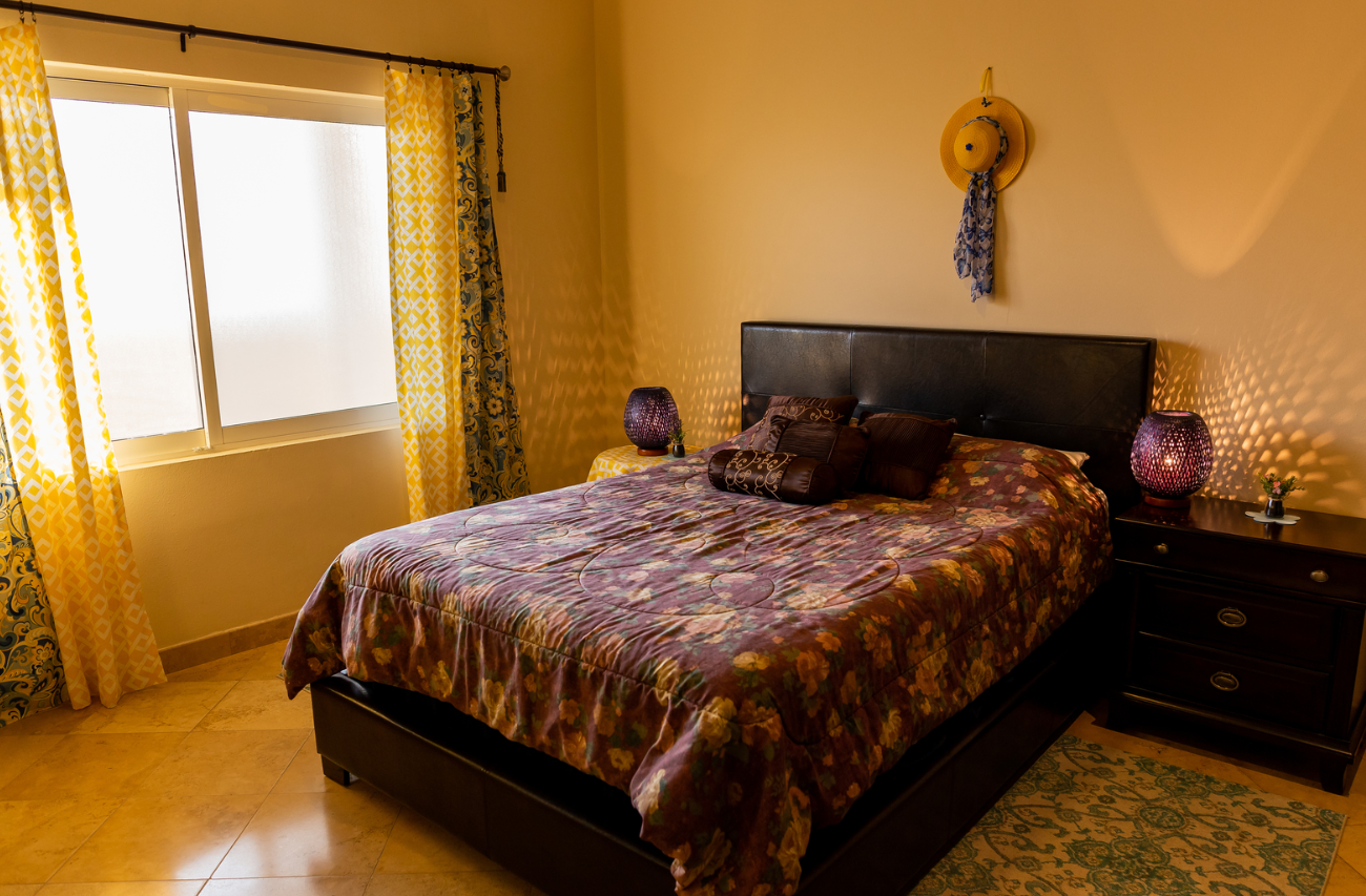 Bed at Puerta Cabos Village Apartment