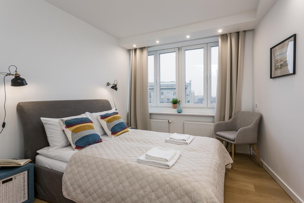 Bedroom at Mirowski Square Apartment
