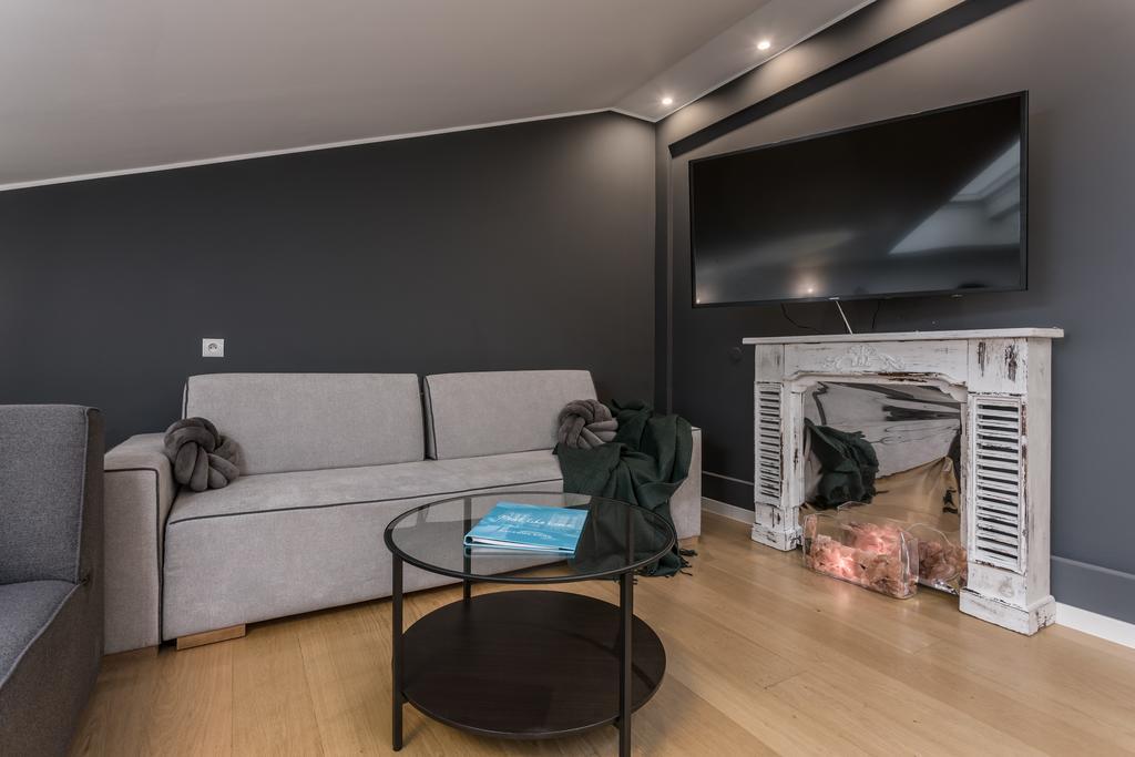 Sofa at Mirowski Square Apartment