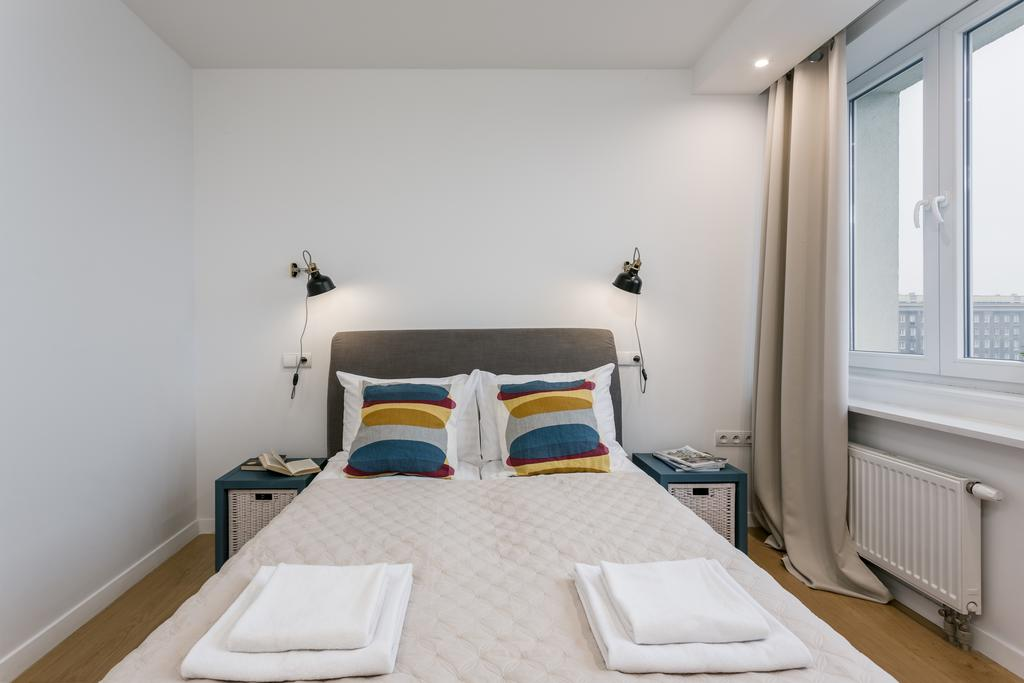 Bed at Mirowski Square Apartment