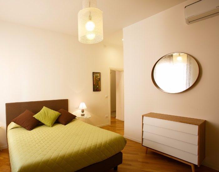 Green bedding at Little De Fiori Apartments