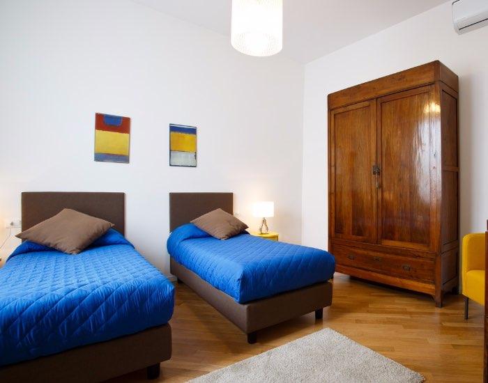 Blue beds at Little De Fiori Apartments