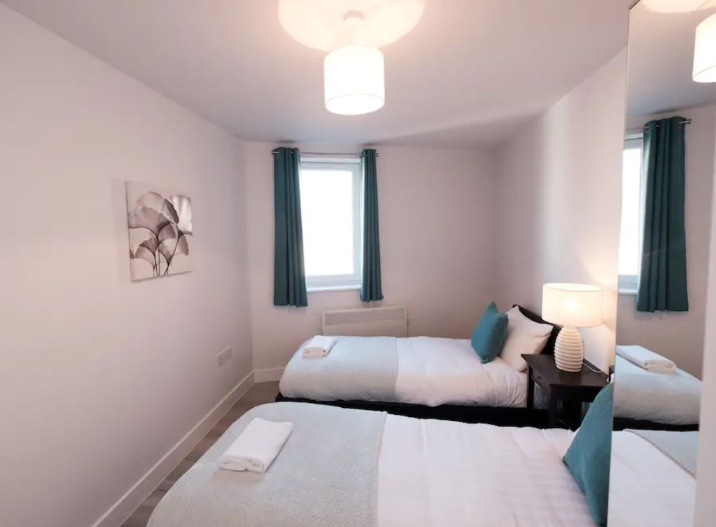 Twin beds at Barall Court Apartments
