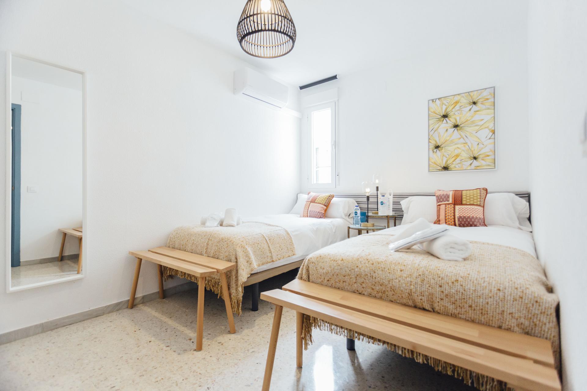 Twin bedroom at Plaza de Zurradores Apartment