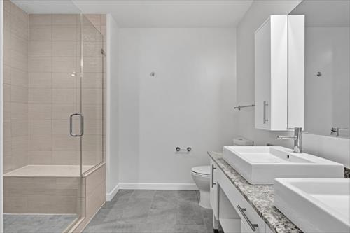 Shower at Flats 8300 Apartments