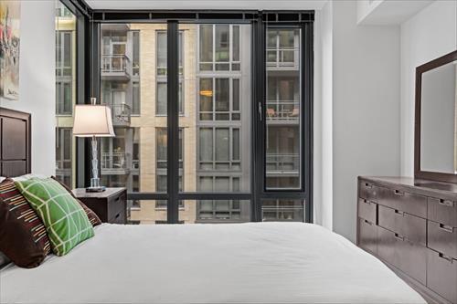 Bed at Flats 8300 Apartments
