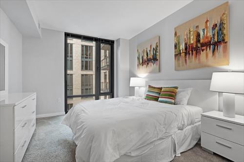 Spacious bedroom at Flats 8300 Apartments