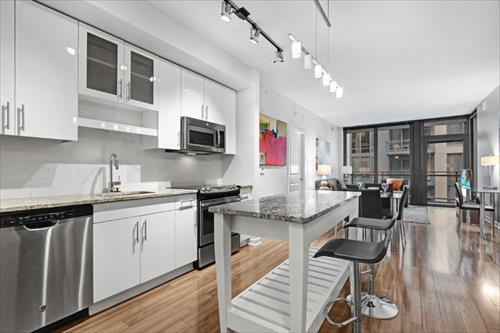 Equipped kitchen at Flats 8300 Apartments