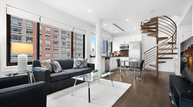 Living room at Living on 8th Apartments, Manhattan, New York