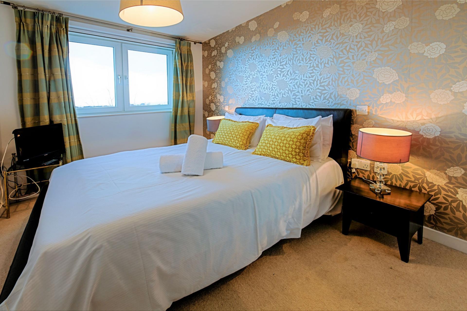 Bedroom at Gunwharf Quays Serviced Apartments