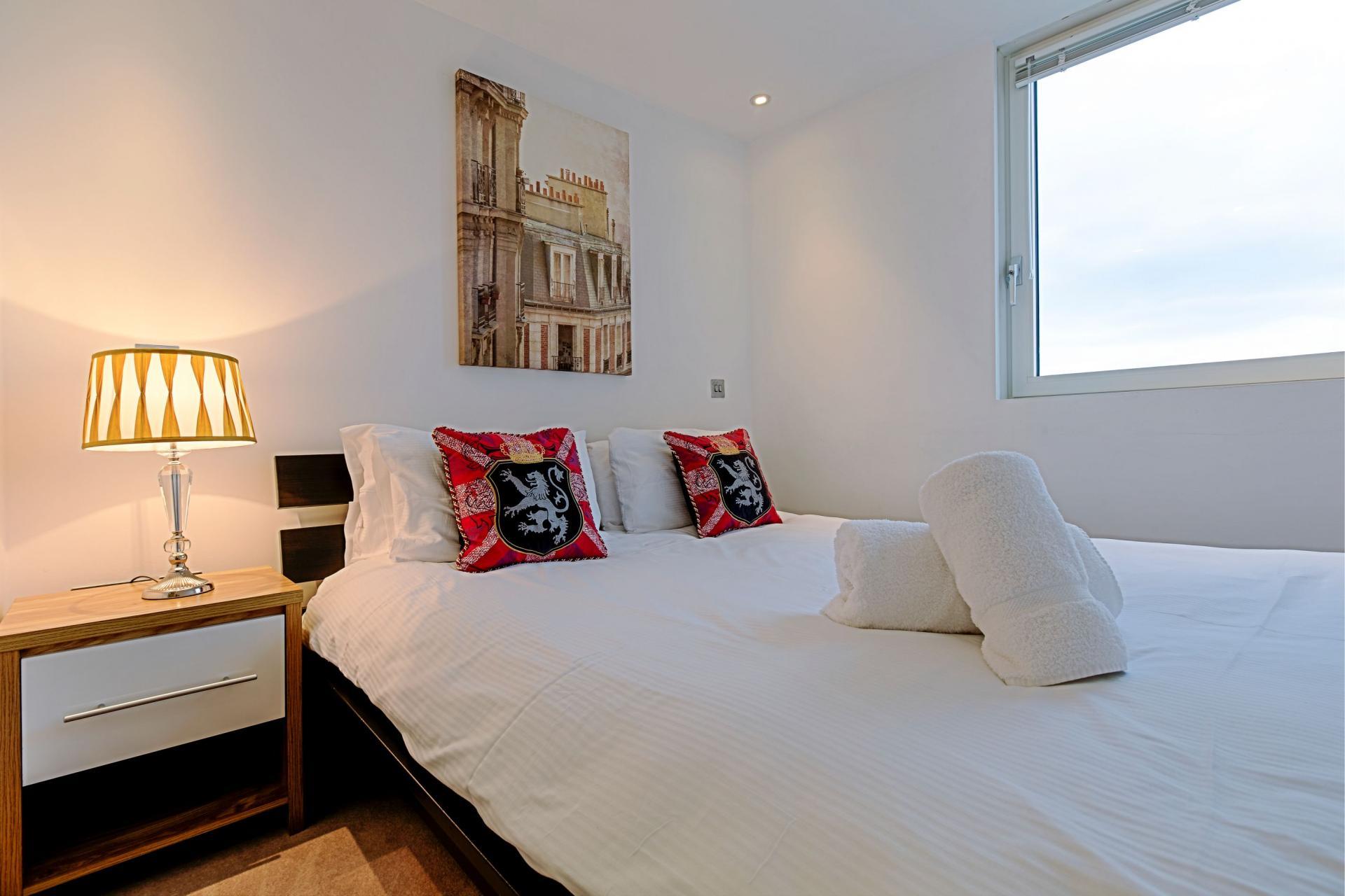 Cosy bed at Gunwharf Quays Serviced Apartments