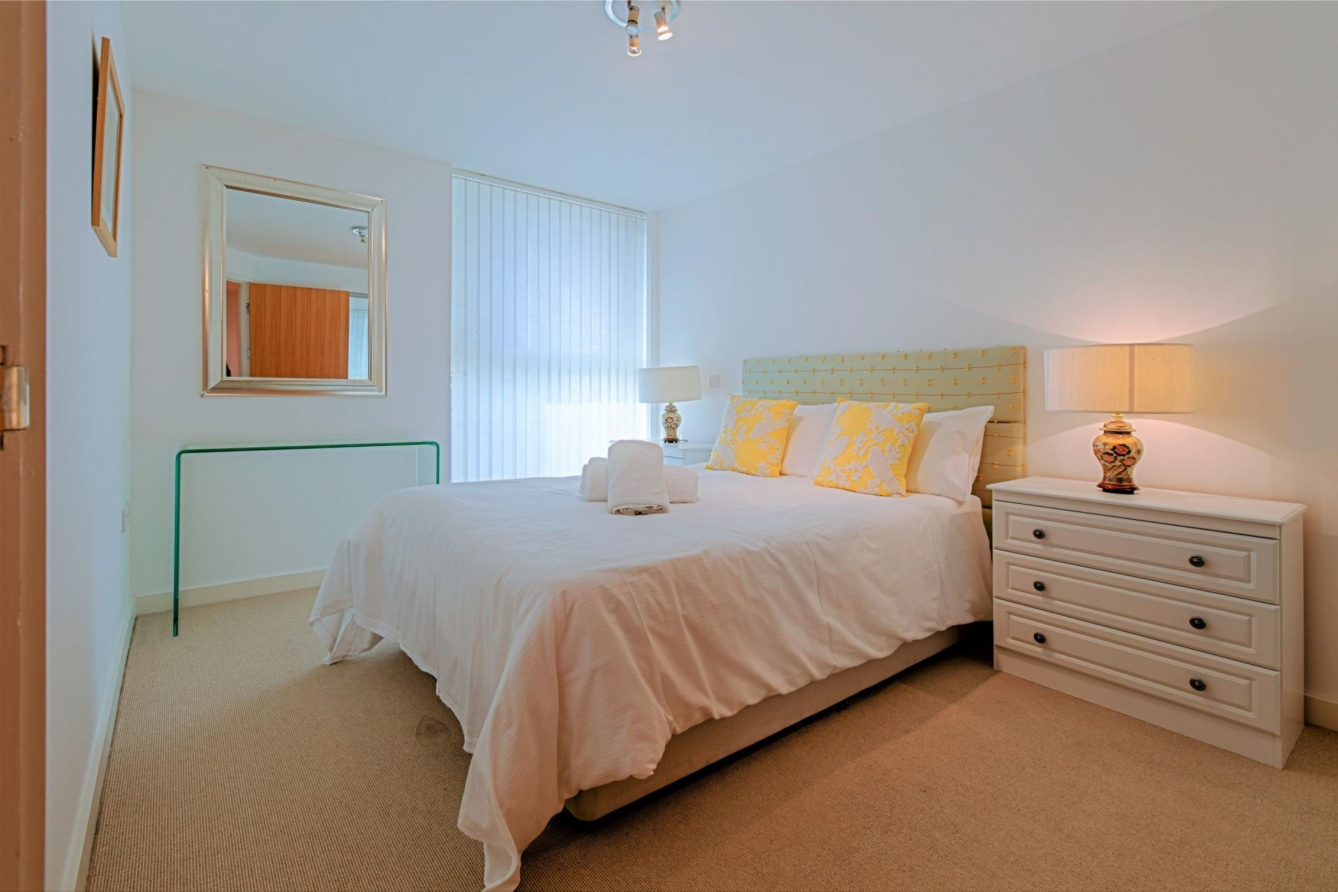 Stylish bedroom at Gunwharf Quays Serviced Apartments