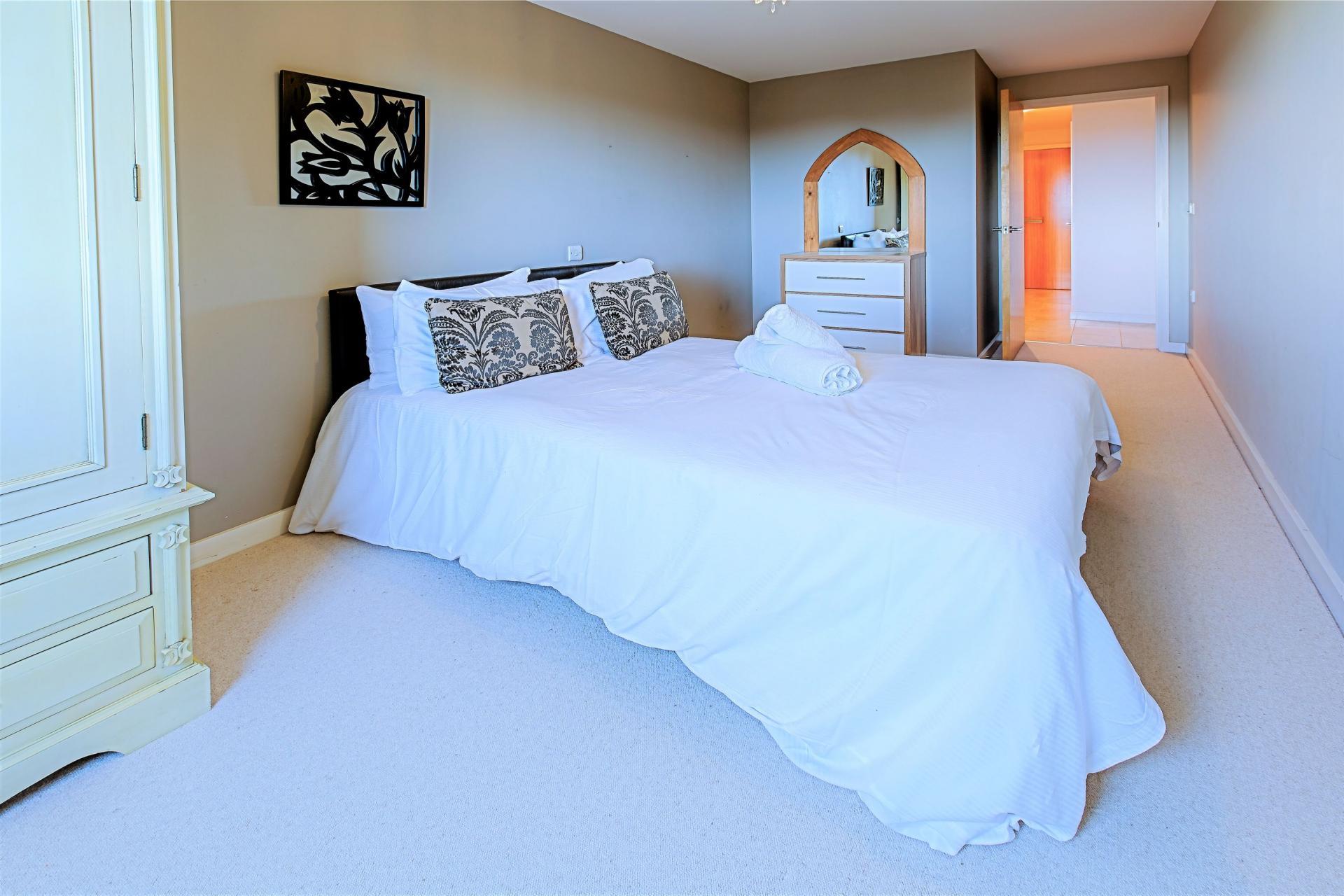Bright bedroom at Gunwharf Quays Serviced Apartments