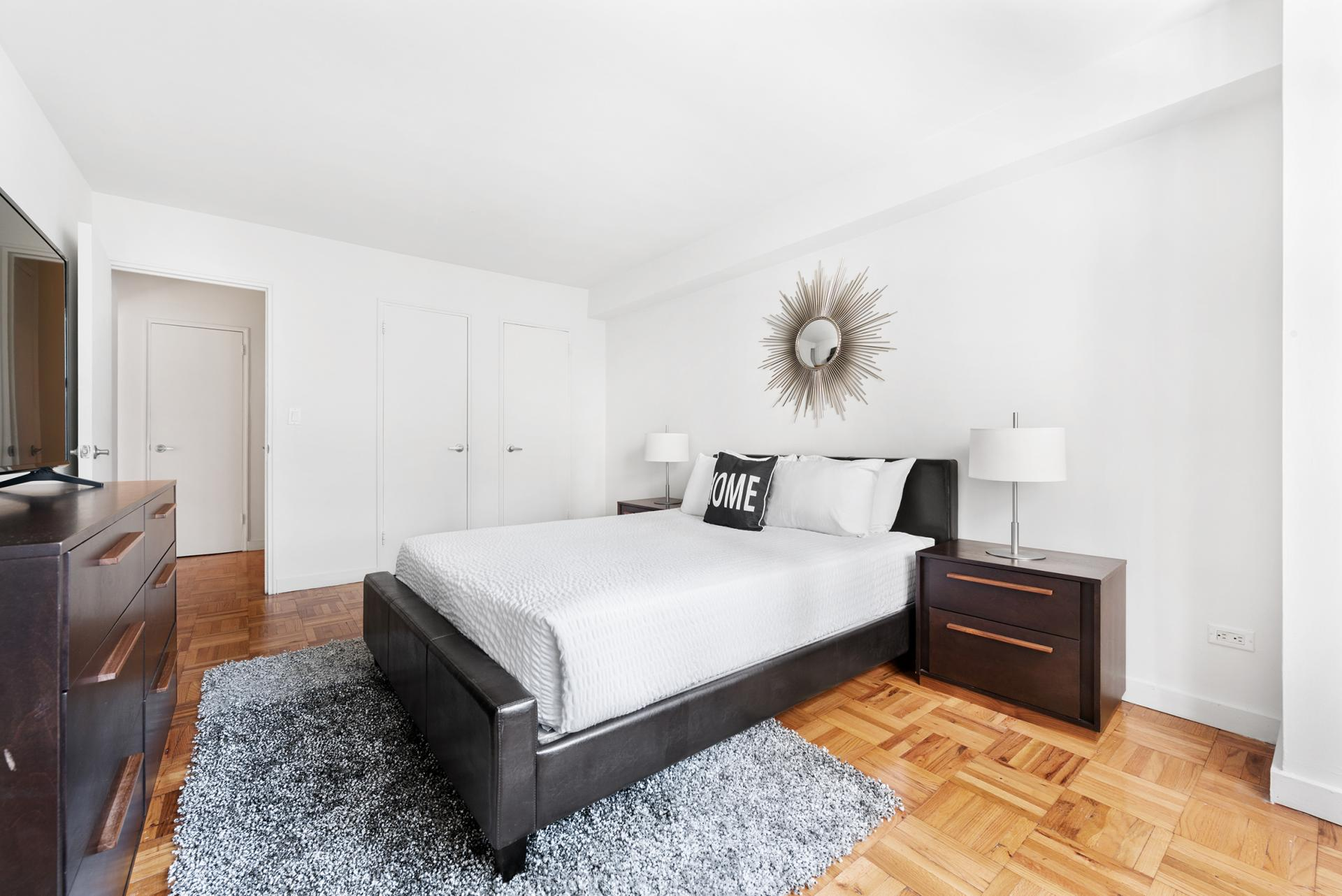Bed at 60 East 12th Street Apartments, Greenwich Village, Manhattan