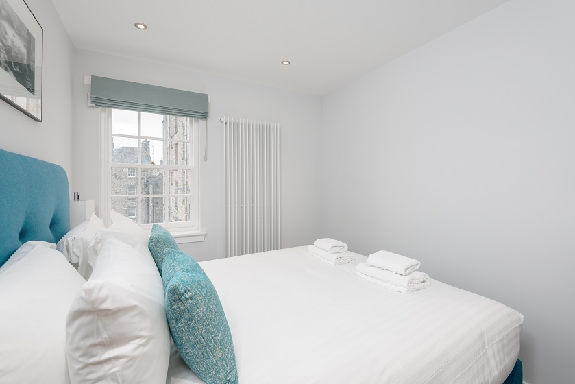 Bright bedroom at Royal Mile Residence Apartments