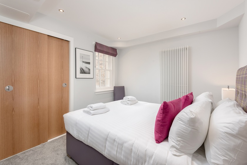 Stylish bedroom at Royal Mile Residence Apartments