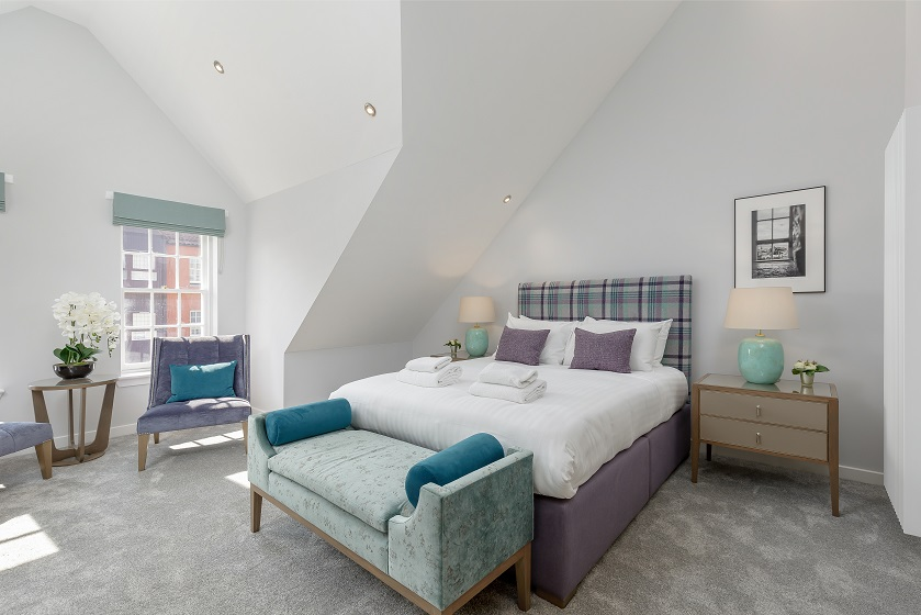Large bedroom at Royal Mile Residence Apartments
