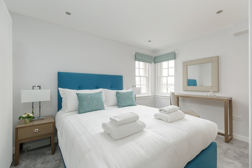 Modern bright bedroom at Royal Mile Residence Apartments