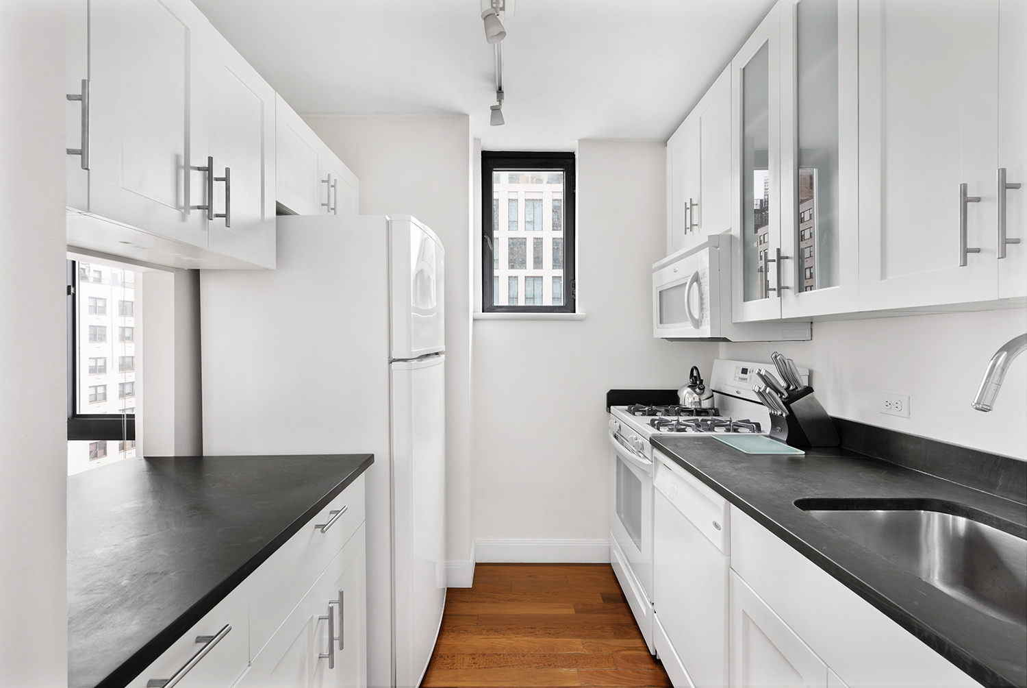Equipped kitchen at Instrata Gramercy Apartments